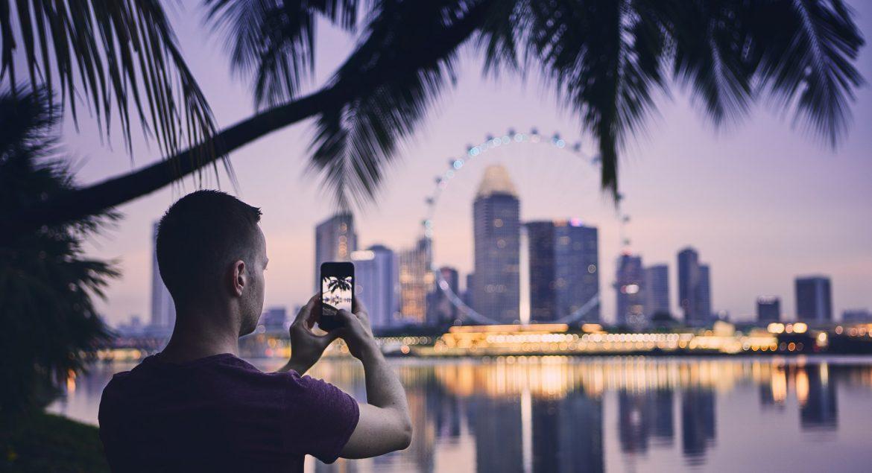 Tourist taking photo of Singapore
