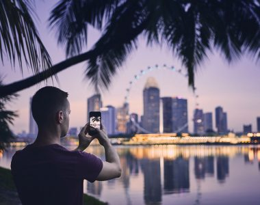 Tourist taking photo of Singapore